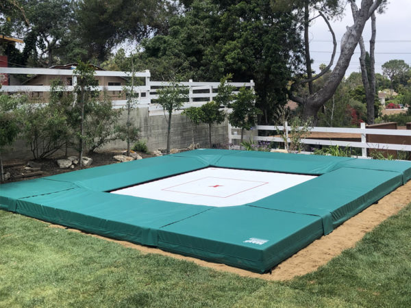Trampoline size is often dependent on the amount of space your have available. This is a 14-foot by 14-foot in ground trampoline.