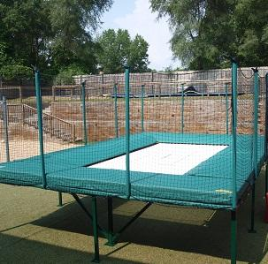 A 7'x14' Deluxe Trampoline. Non folding, but can have legs removed to become an in ground tramp.