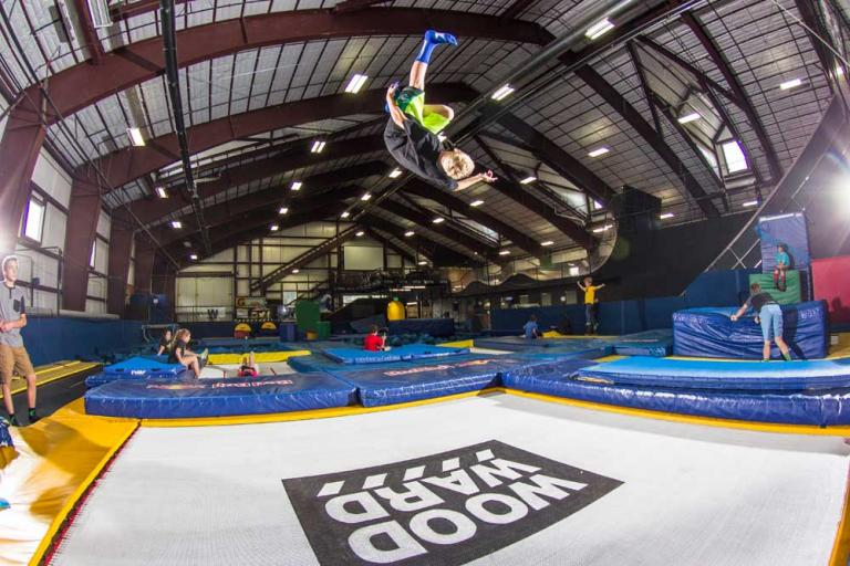 An athlete training on one of MaxAir's commercial trampolines in Woodward