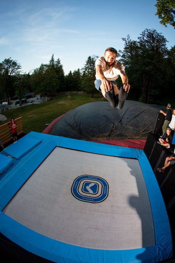 Someone reaching new heights on one of MaxAir Trampoline's super tramps.