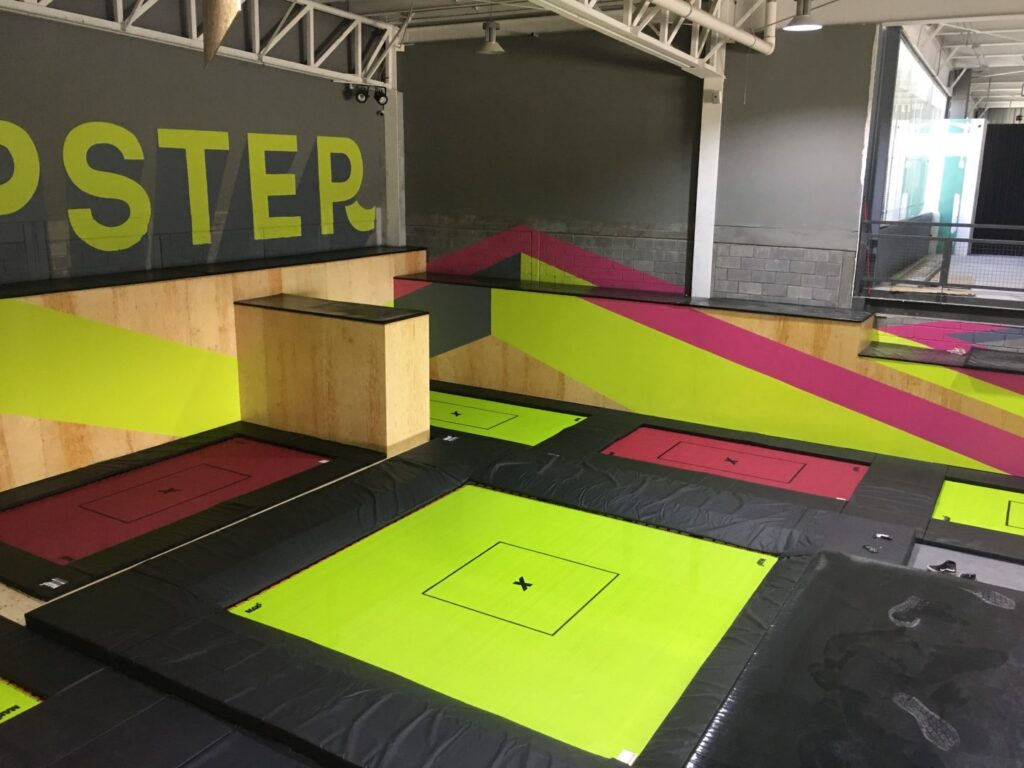 Yellow and pink custom trampolines for Jumpster indoor park in Monterrey, Mexico.