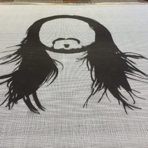 Custom trampoline beds can feature logos on 16 square feet of bed surface. A Steve Aoki (DJ) custom trampoline bed.