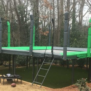 An above-ground, durable trampoline with safety netting.