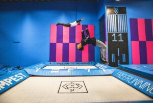 MaxAir is know for the extreme sports trampoline training centers around the country. An athlete performs a backflip in a trampoline center.